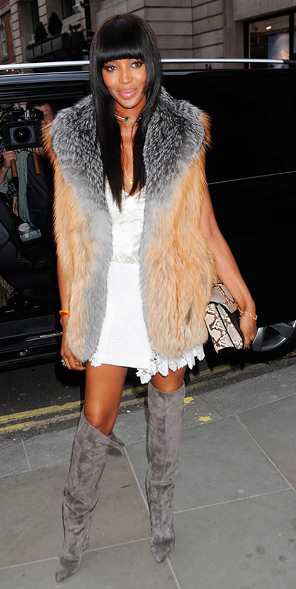 comfort-dramatic-style-type-naomicampbell-white-dress-mini-gray-knee-boots-fur-vest-tan-bangs-hair-long-black-model-street-style.jpg