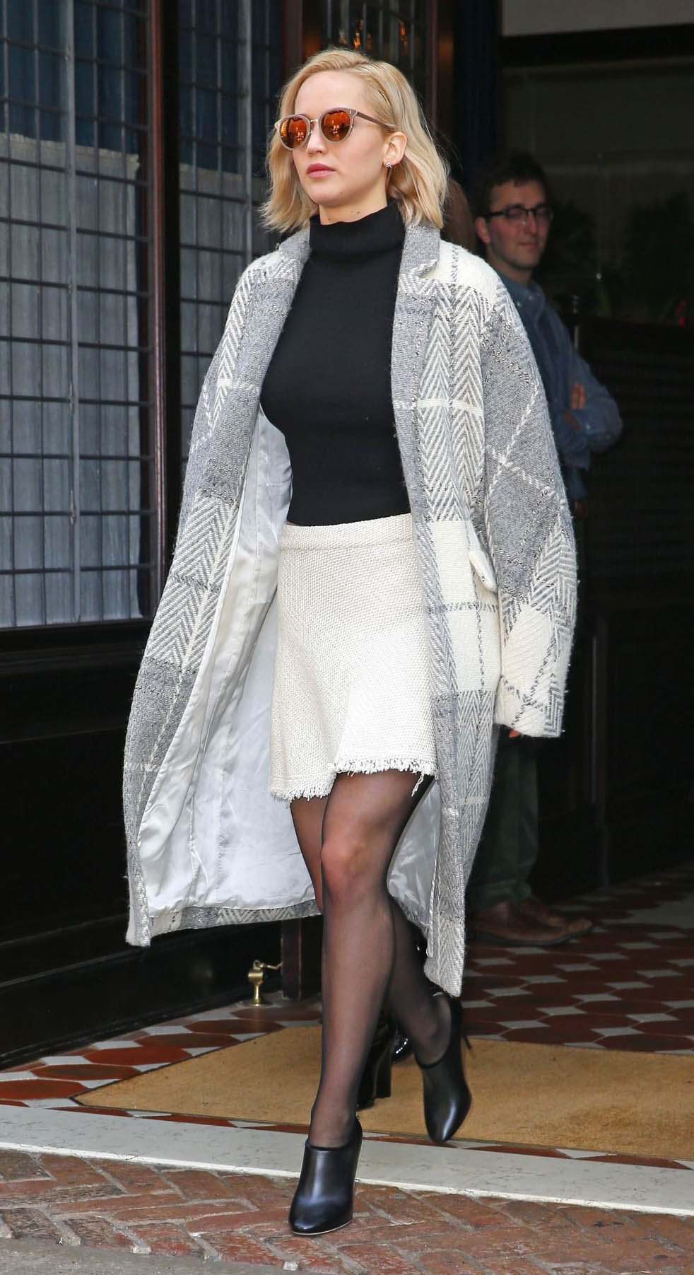white-mini-skirt-black-sweater-turtleneck-black-tights-black-shoe-booties-grayl-jacket-coatigan-plaid-sun-jenniferlawrence-style-fall-winter-blonde-work.jpg