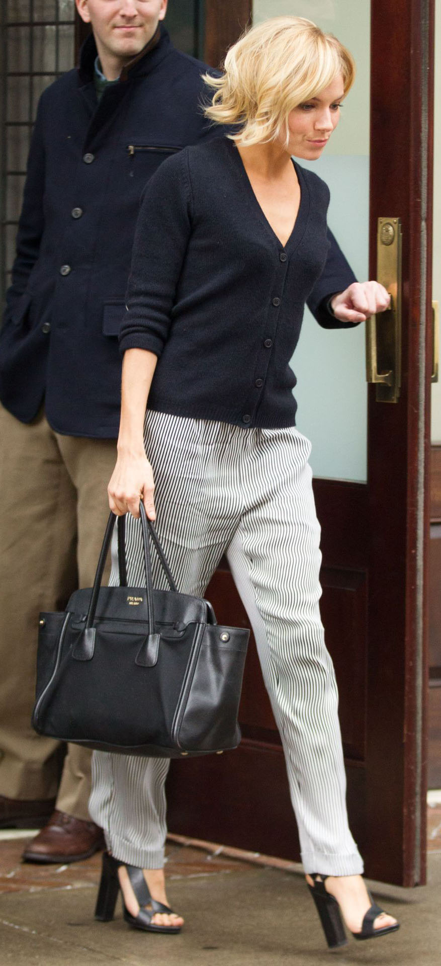 grayl-joggers-pants-stripe-black-cardigan-black-bag-black-shoe-sandalh-siennamiller-spring-summer-blonde-work.jpg