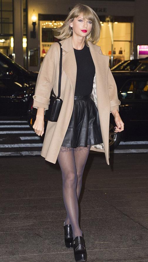 black-mini-skirt-black-sweater-black-bag-taylorswift-wear-style-fashion-fall-winter-black-shoe-booties-brown-tights-tan-jacket-coat-dinner-blonde-dinner.jpg
