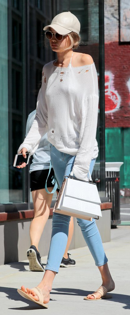 blue-light-skinny-jeans-white-sweater-white-bralette-white-bag-hat-cap-sun-blonde-pony-tan-shoe-sandals-gigihadid-howtowear-fashion-style-outfit-spring-summer-weekend.jpg
