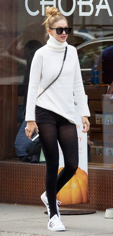 black-shorts-white-sweater-howtowear-fashion-style-outfit-fall-winter-turtleneck-black-bag-bun-sun-white-shoe-sneakers-black-tights-gigihadid-blonde-weekend.jpg