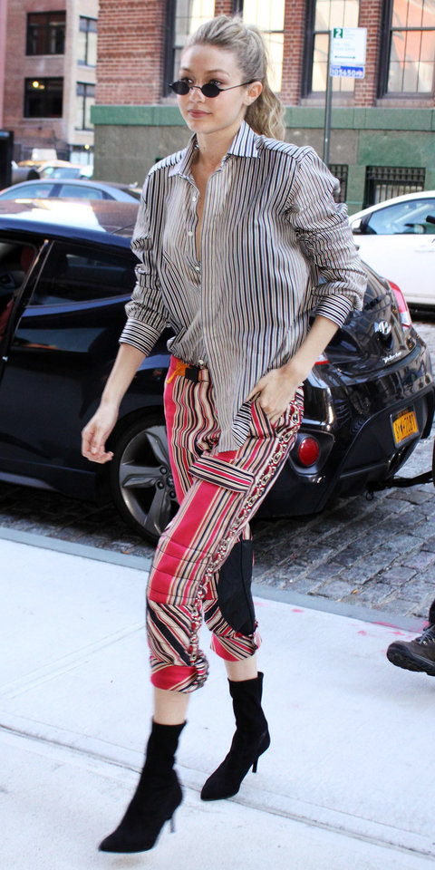 red-joggers-pants-print-mix-black-top-collared-shirt-stripe-black-shoe-booties-sun-gigihadid-spring-summer-blonde-lunch.jpg