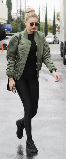 black-leggings-black-tee-green-olive-jacket-bomber-black-bag-gigihadid-wear-outfit-fashion-fall-winter-black-shoe-sneakers-sun-bun-athleisure-blonde-lunch.jpg