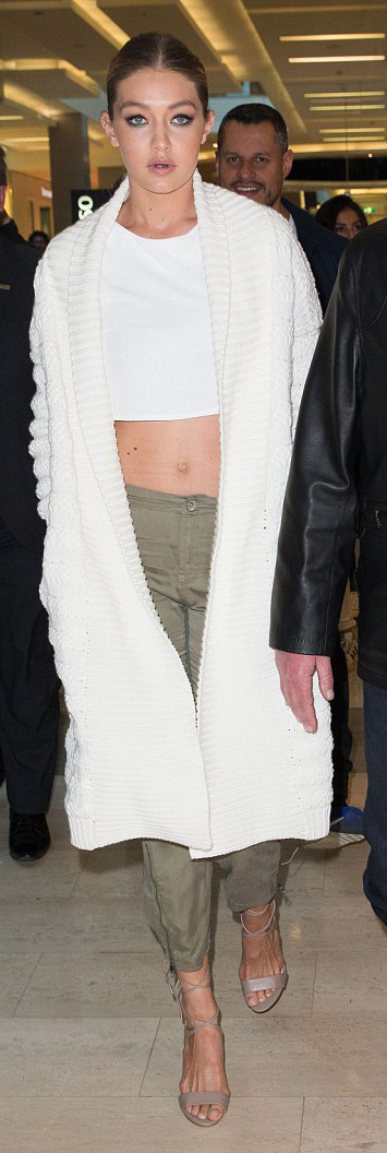 green-olive-joggers-pants-white-top-crop-white-cardiganl-bun-tan-shoe-sandalh-wear-style-fashion-spring-summer-gigihadid-celebrity-blonde-celebrity-dinner.jpg
