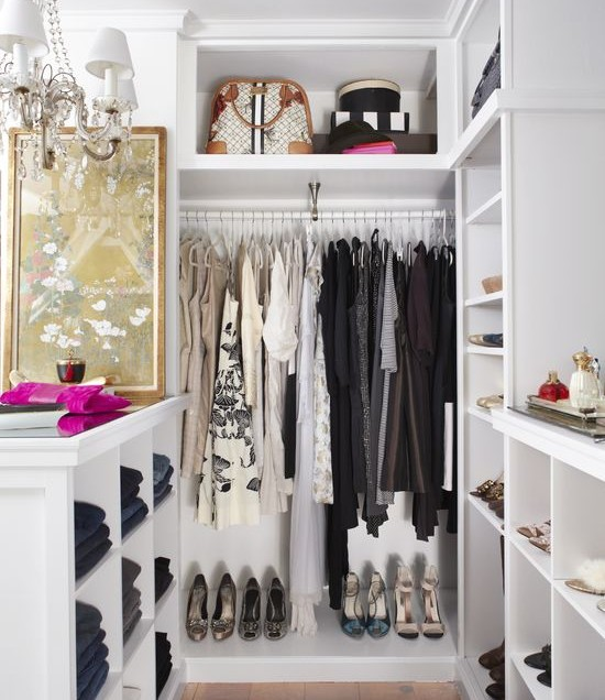 how-to-organize-your-clothes-wardrobe-storage-shelves-handbags-shoes-folded-dresses-chandelier-jeans-white.jpeg