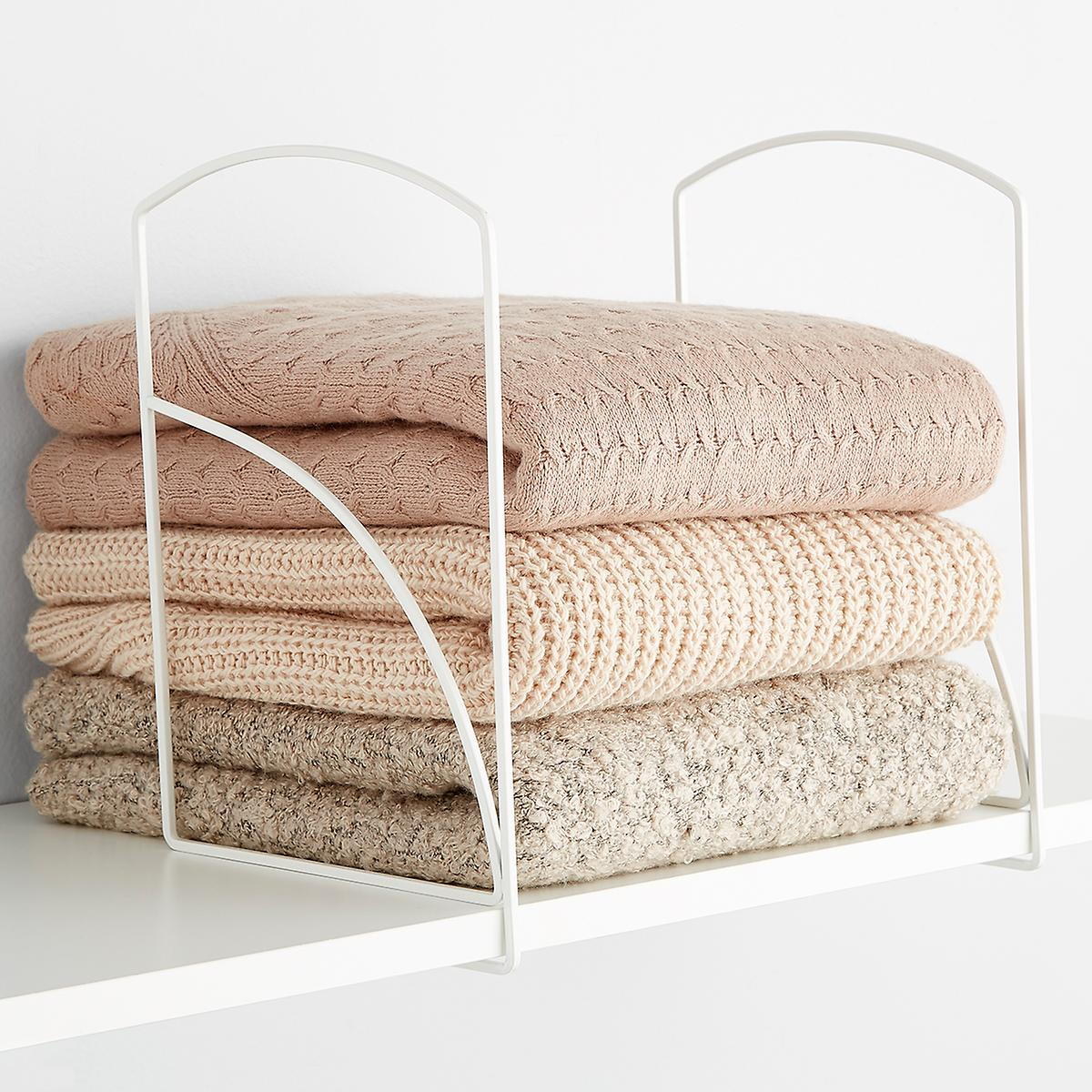 Lynk Tall White Shelf Dividers, $10/pkg at The Container Store - These useful dividers keep your purses, sweaters and T-shirts in line. (They also work wonders for linens, towels, books and cookie sheets.)