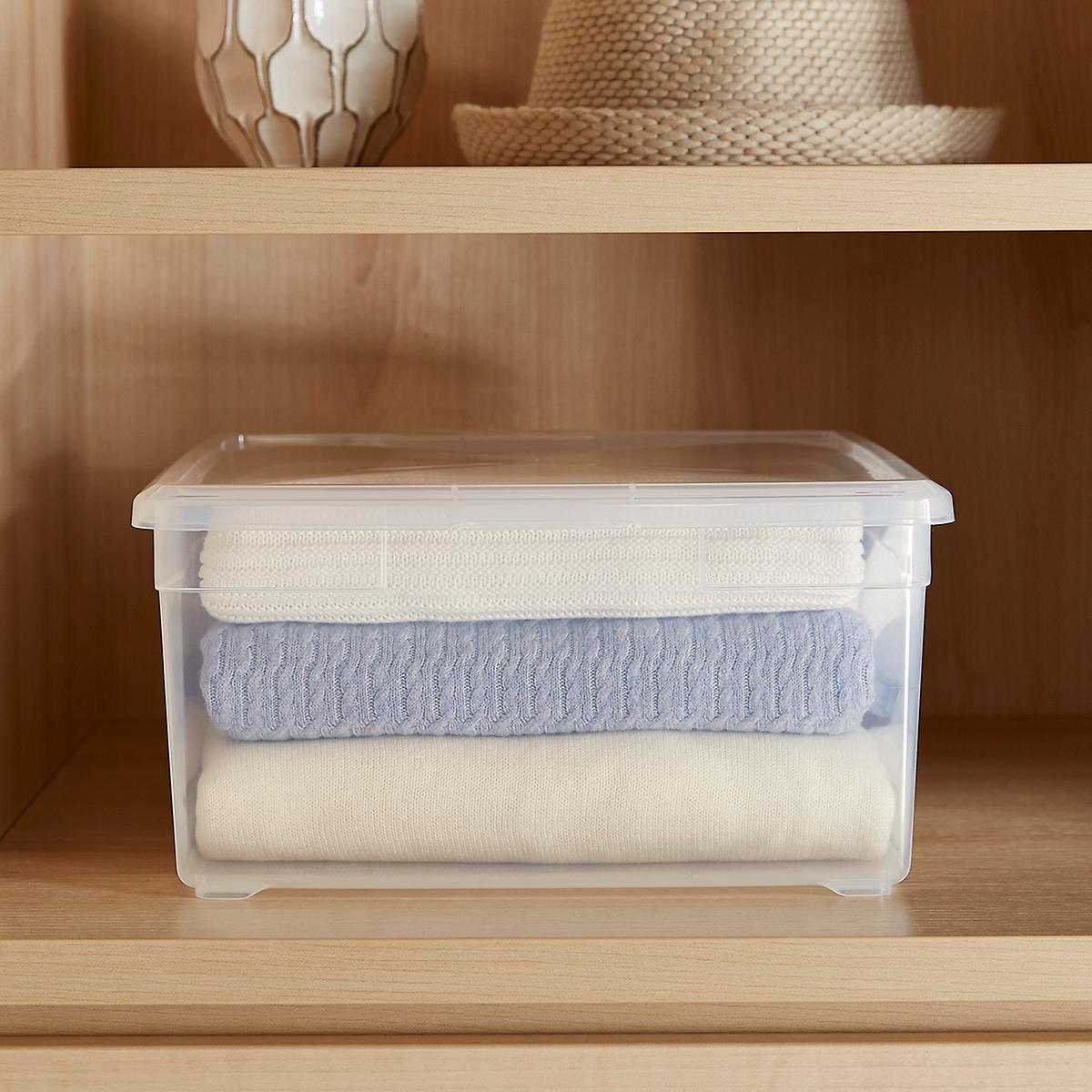 Sweater Box, $6.50 at The Container Store - The Container Store has excellent simple plastic storage boxes in many sizes!