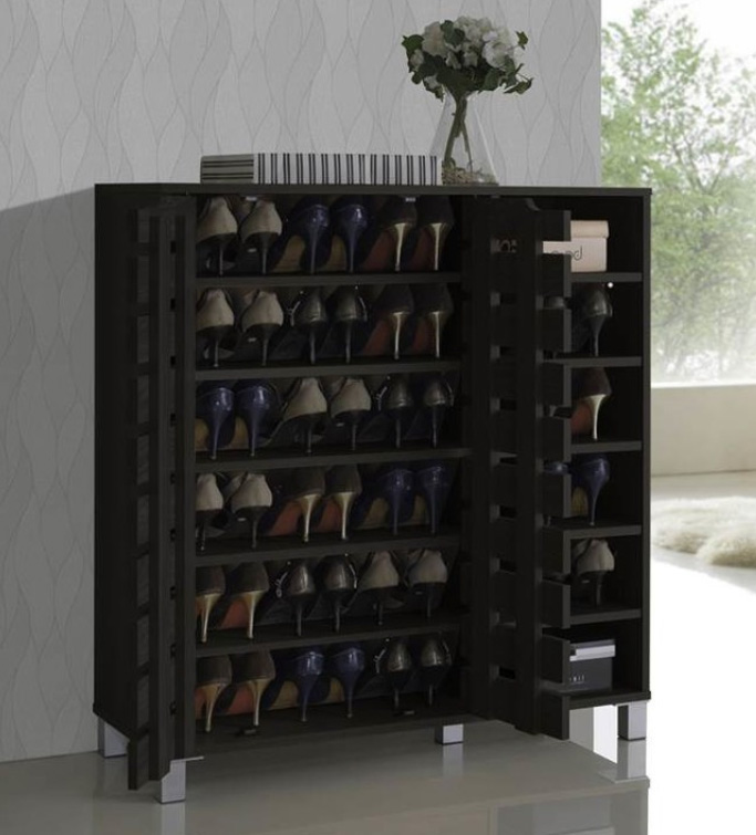 Shirley Wood 2-Door Shoe Cabinet with Open Shelves, $154 at Houzz - An elegant little shoe cabinet that can hold many pairs. We like the slatted doors that allow the shoes to breathe!