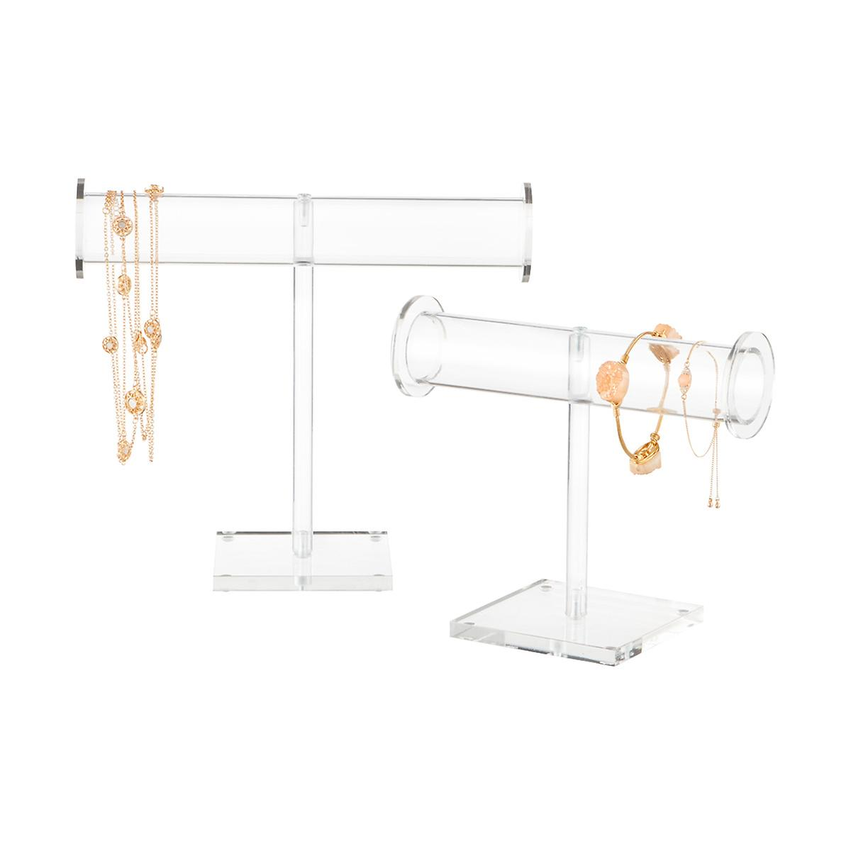 Acrylic Jewelry Stands, $15-$20 at The Container Store - We love how the clear acrylic of these stands allows the jewelry to stand out and goes with any decor!