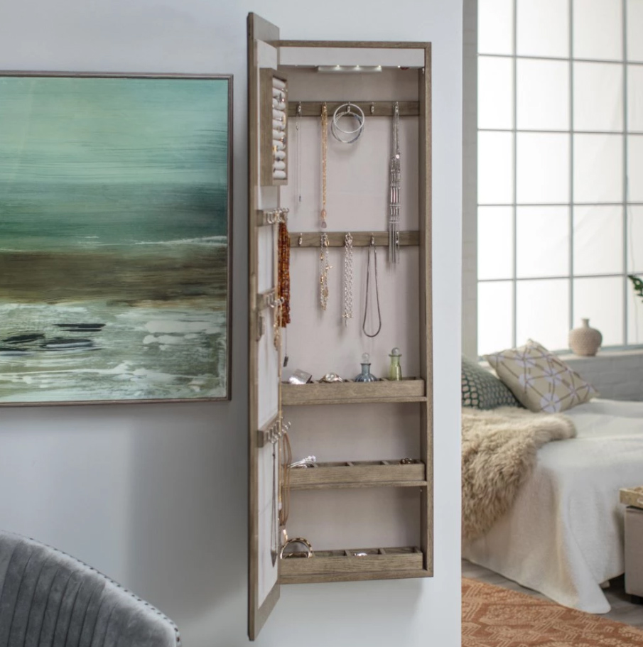 Belham Living Lighted Wall Mount Locking Jewelry Armoire, $180 at Hayneedle - Gray driftwood and a mirrored front make this a wall-mounted winner!