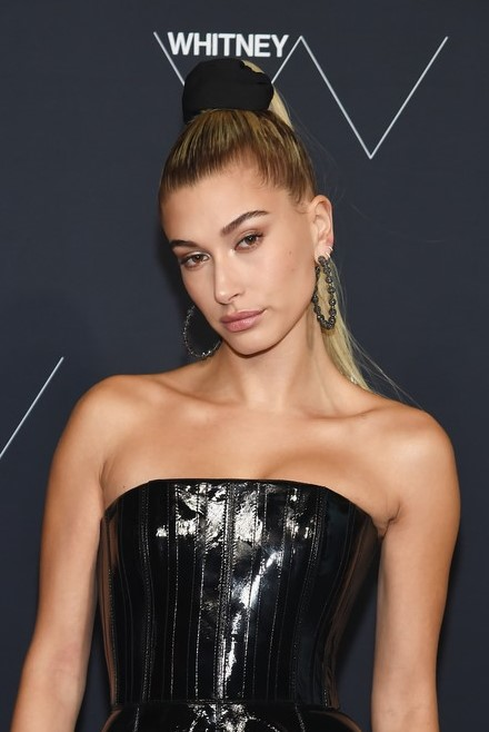 how-to-style-hair-accessories-scrunchies-hairstyles-ways-to-wear-ponytail-haileybaldwin-looks-sleek-in-black-leather-dress-at-whitney-gala.jpg