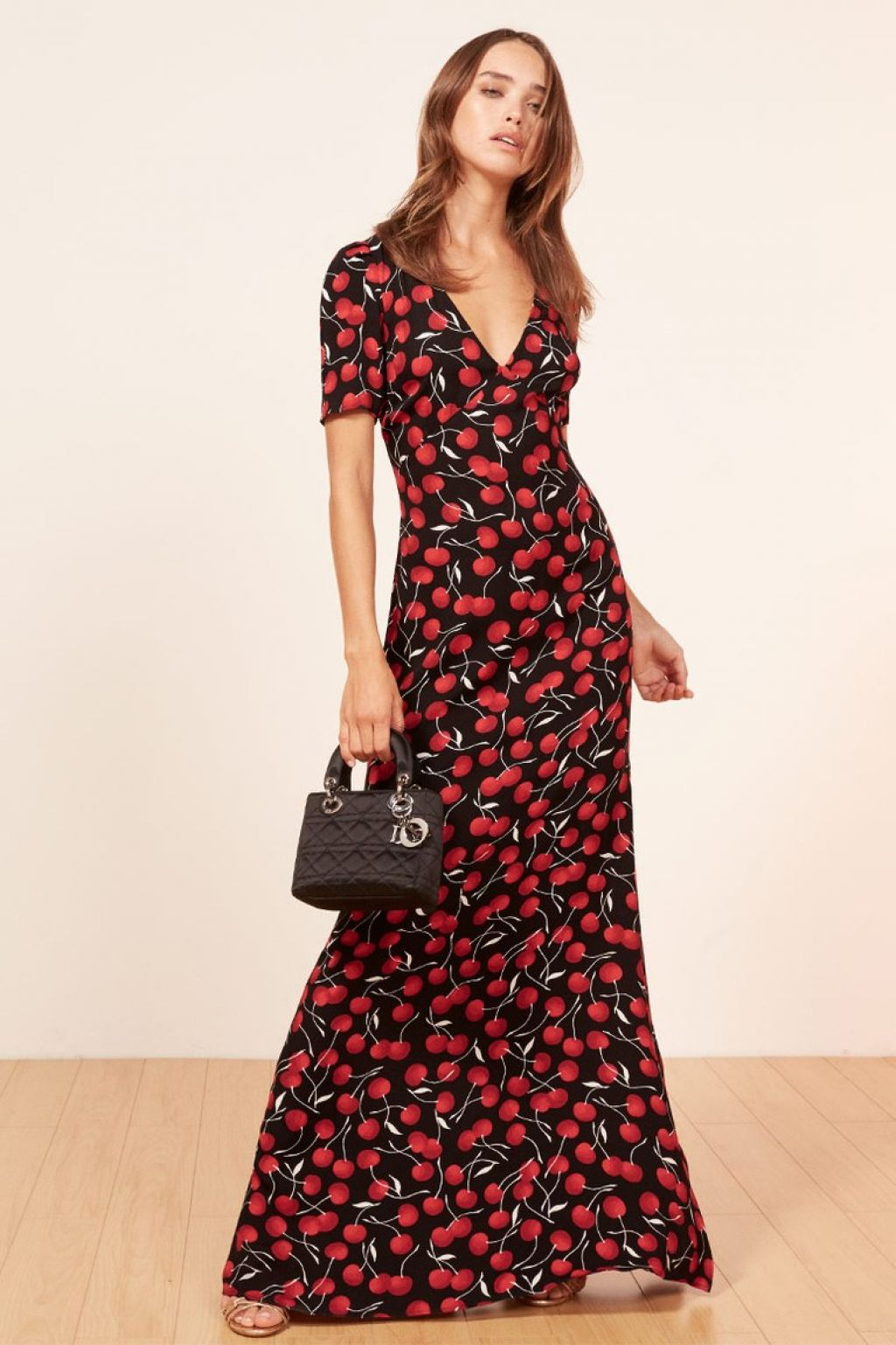 what-to-wear-for-a-spring-wedding-guest-outfit-red-dress-maxi-cherry-print-black-bag-dinner.jpeg