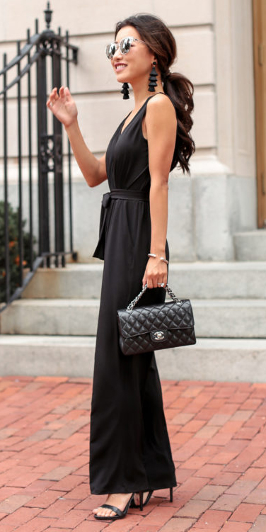 what-to-wear-for-a-spring-wedding-guest-outfit-black-jumpsuit-earrings-brun-pony-black-bag-mono-black-shoe-sandalh-dinner.jpg