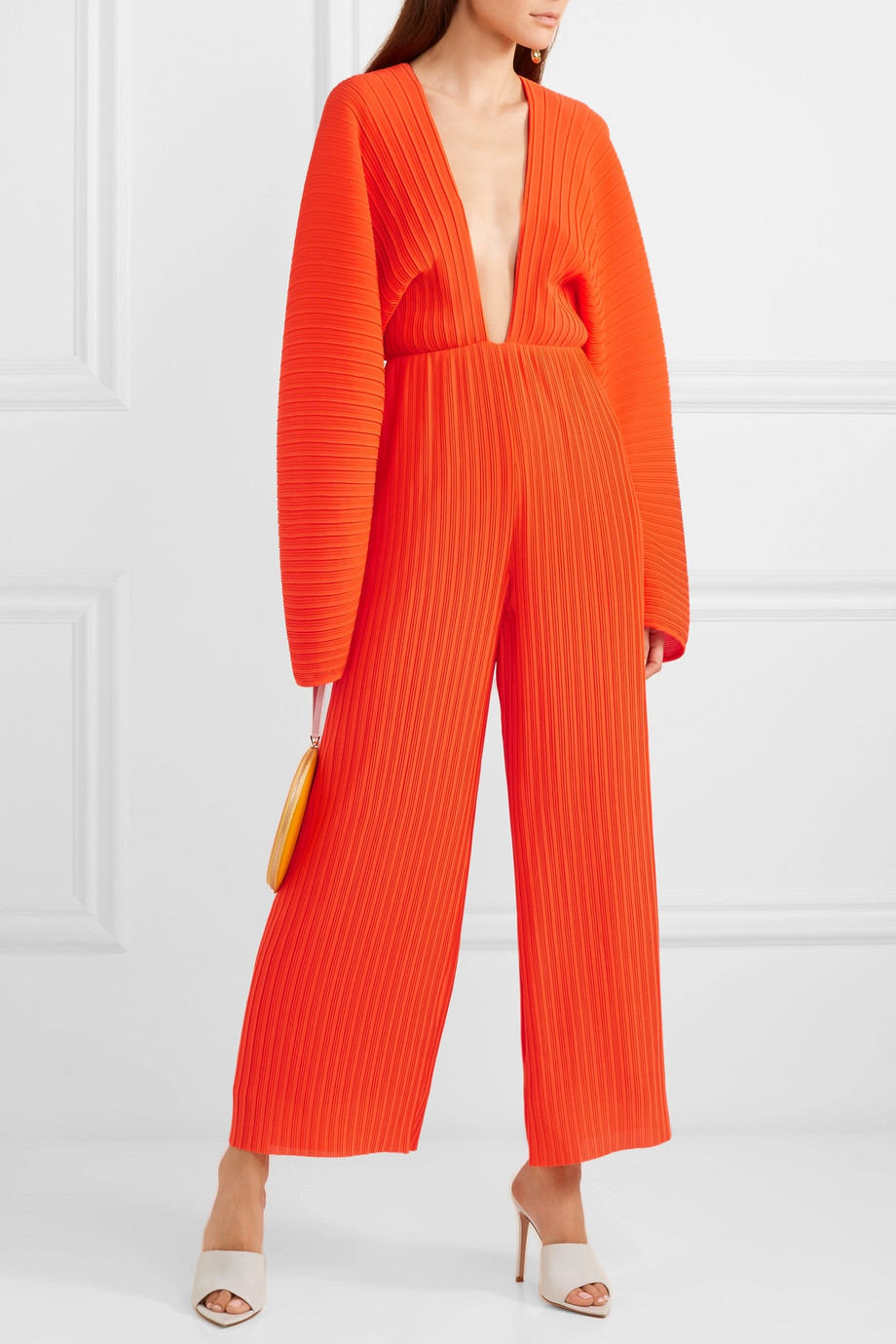 what-to-wear-for-a-spring-wedding-guest-outfit-orange-jumpsuit-hairr-white-shoe-sandalh-dinner.jpg