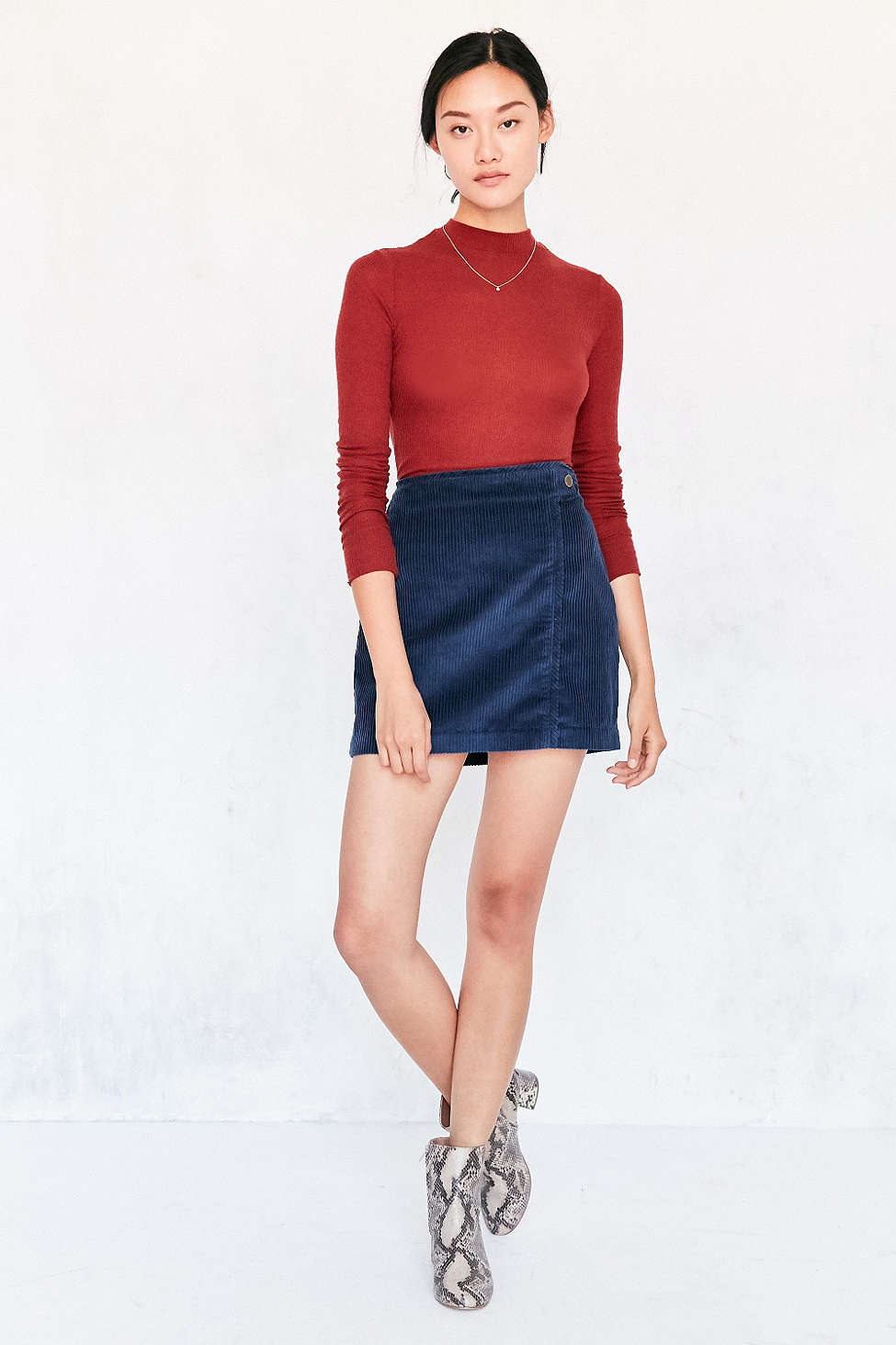 blue-navy-mini-skirt-red-sweater-wear-style-fashion-fall-winter-white-shoe-booties-necklace-bun-snakeskin-brun-lunch.jpg