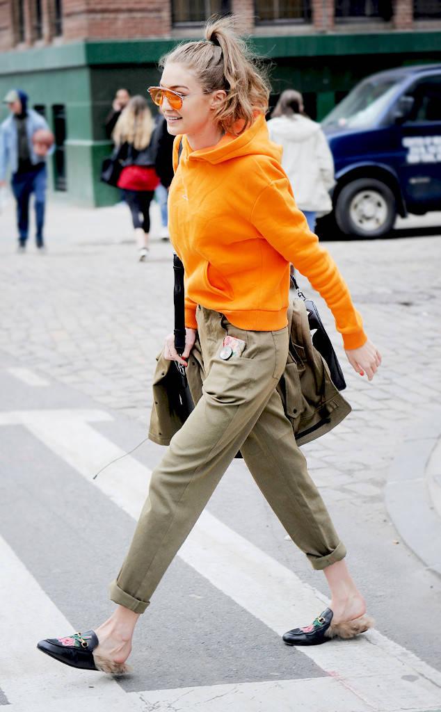 green-olive-chino-pants-orange-sweater-hoodie-sun-pony-black-shoe-loafers-slides-fall-winter-gigihadid-blonde-weekend.jpg