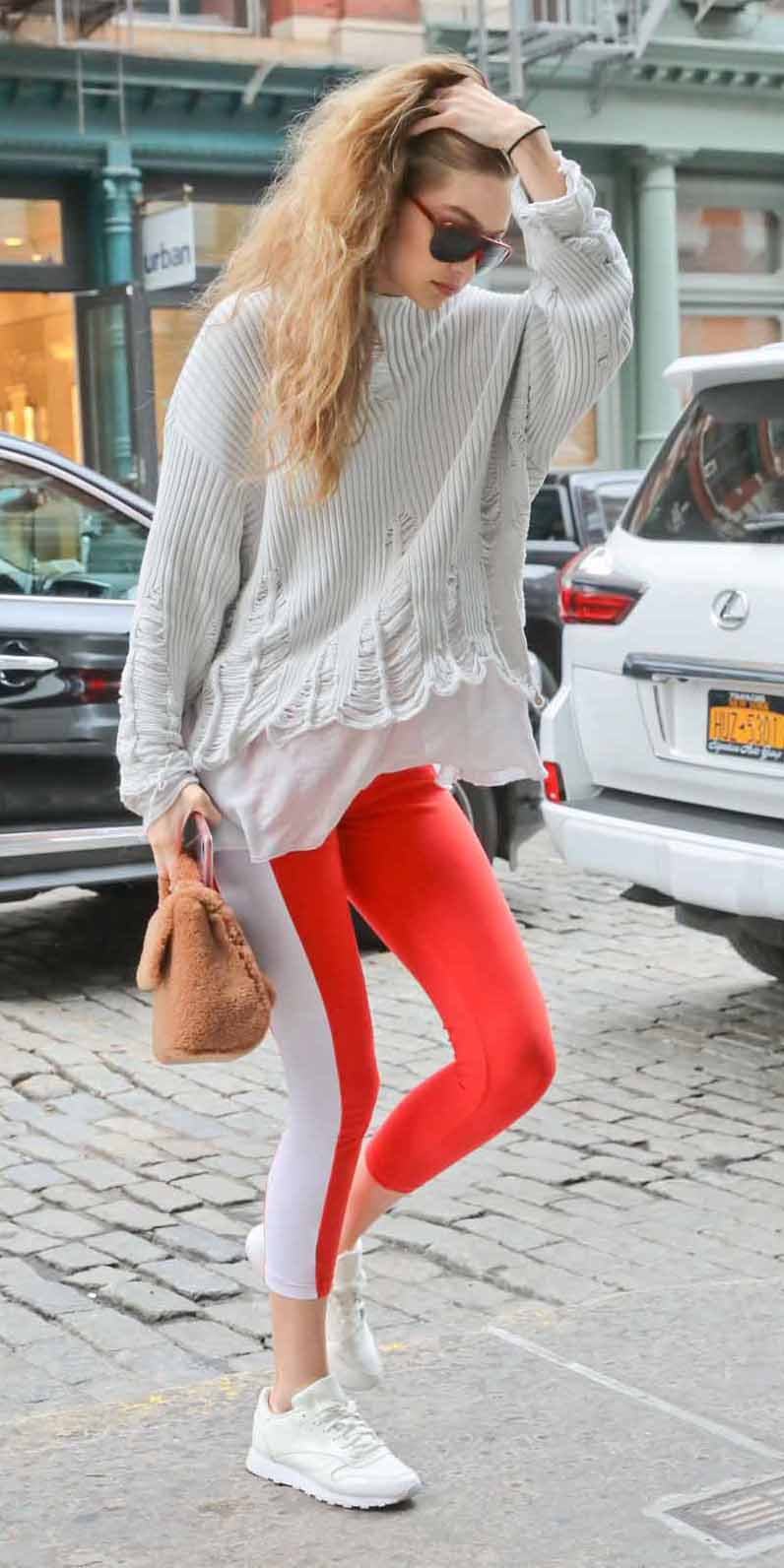 red-leggings-white-sweater-blonde-sun-gigihadid-cognac-bag-fur-white-shoe-sneakers-fall-winter-weekend.jpg