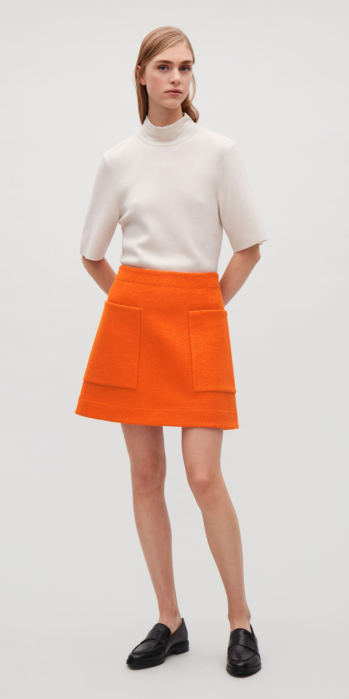 orange-mini-skirt-white-sweater-black-shoe-loafers-fall-winter-blonde-lunch.jpg