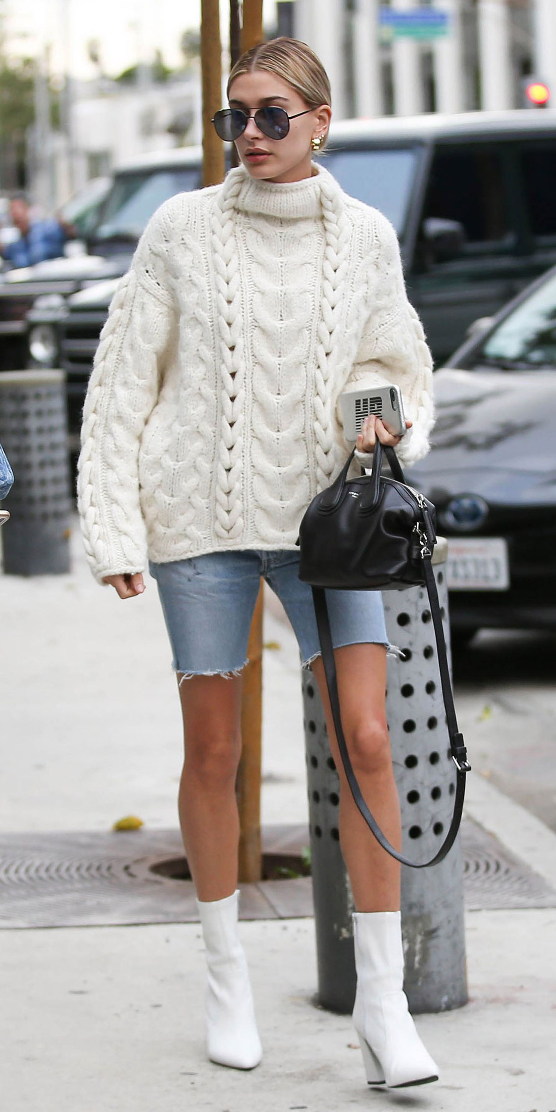 blue-light-shorts-denim-white-sweater-blonde-bun-studs-sun-black-bag-white-shoe-booties-haileybaldwin-fall-winter-lunch.jpg