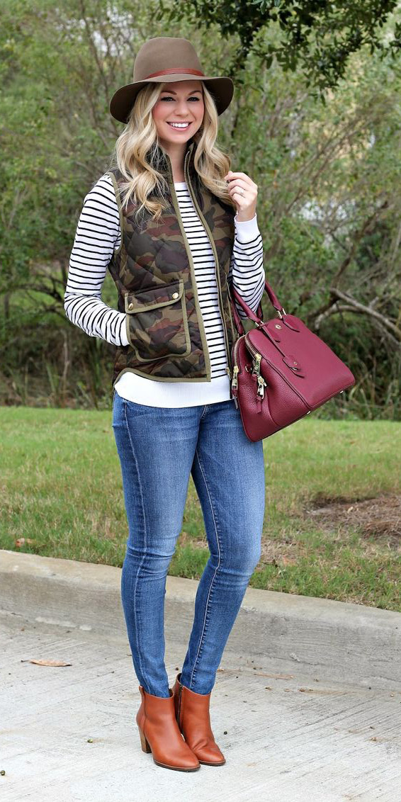 blue-med-skinny-jeans-cognac-shoe-booties-white-sweater-stripe-camo-print-green-olive-vest-puffer-burgundy-bag-blonde-hat-fall-winter-weekend.jpg