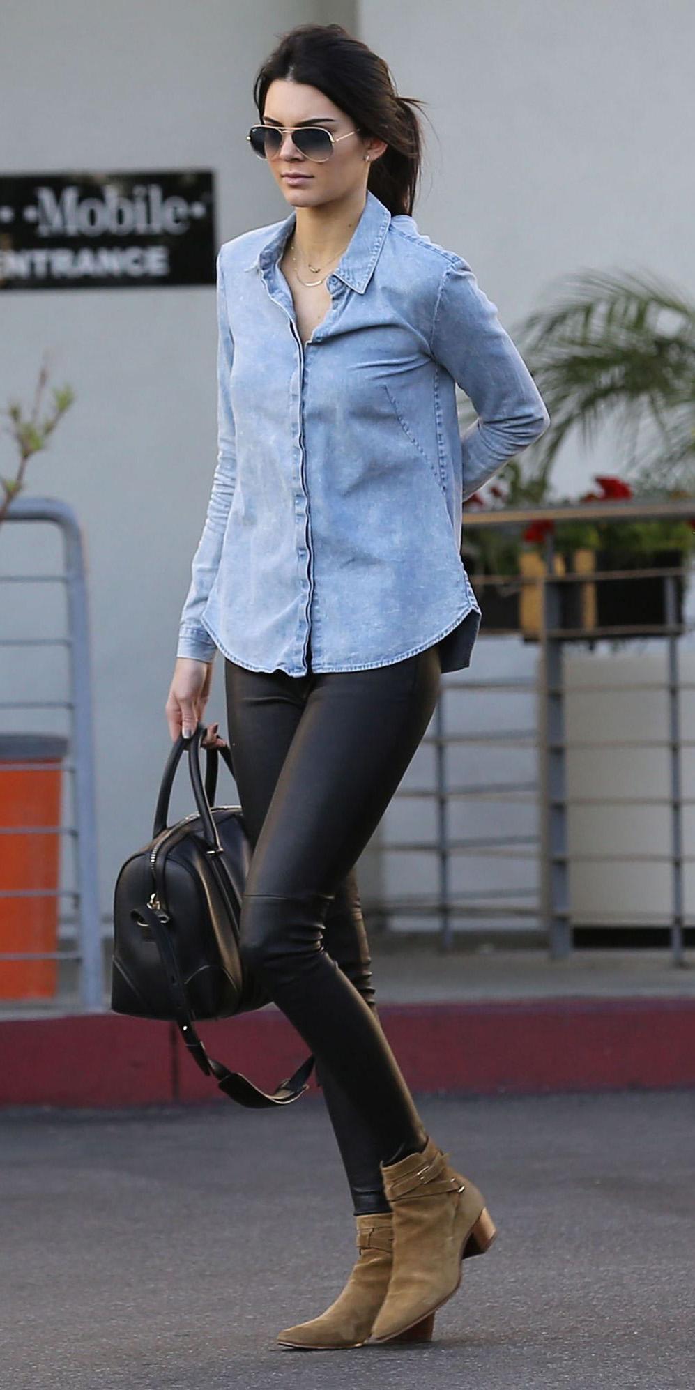 black-leggings-blue-light-collared-shirt-sun-pony-black-bag-tan-shoe-booties-wear-style-fashion-spring-summer-chambray-kendalljenner-celebrity-brun-weekend.jpg