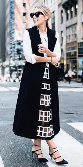 black-midi-skirt-white-collared-shirt-blonde-pony-sun-black-shoe-pumps-black-vest-tailor-fall-winter-work.jpg