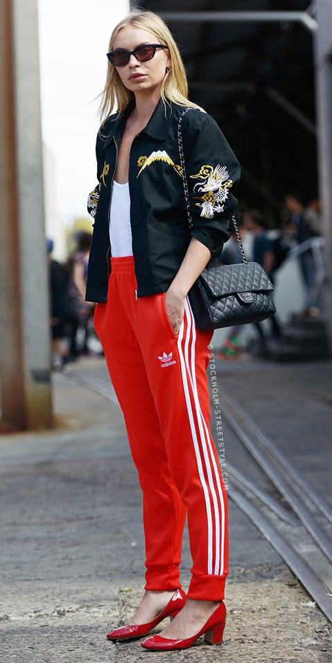 red-joggers-pants-white-tee-black-jacket-black-bag-sun-red-shoe-pumps-trackpants-blonde-fall-winter-lunch.jpg