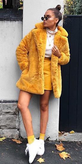 yellow-mini-skirt-white-tee-turtleneck-necklace-yellow-jacket-coat-sun-hairr-bun-socks-white-shoe-sneakers-fall-winter-weekend.jpg