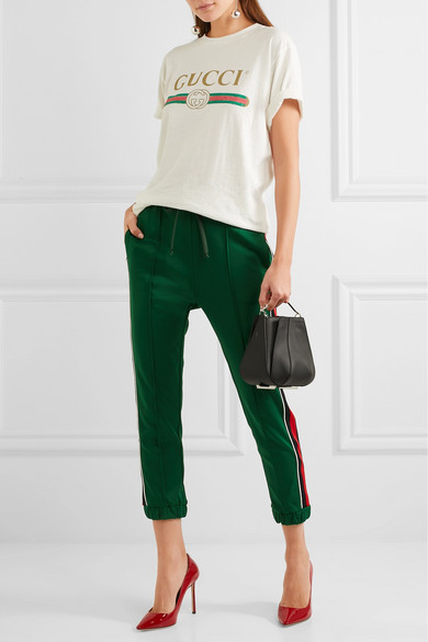 green-dark-joggers-pants-track-white-graphic-tee-red-shoe-pumps-hairr-fall-winter-lunch.jpg