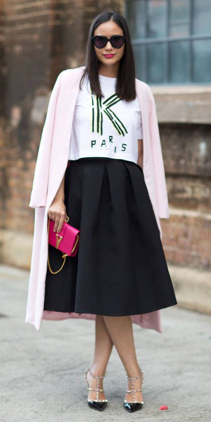 black-midi-skirt-pink-bag-white-graphic-tee-sun-black-shoe-pumps-pink-light-jacket-coat-fall-winter-brun-dinner.jpg