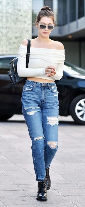 blue-med-boyfriend-jeans-bellahadid-white-top-offshoulder-black-shoe-booties-black-bag-pack-bun-sun-brun-spring-summer-weekend.jpg