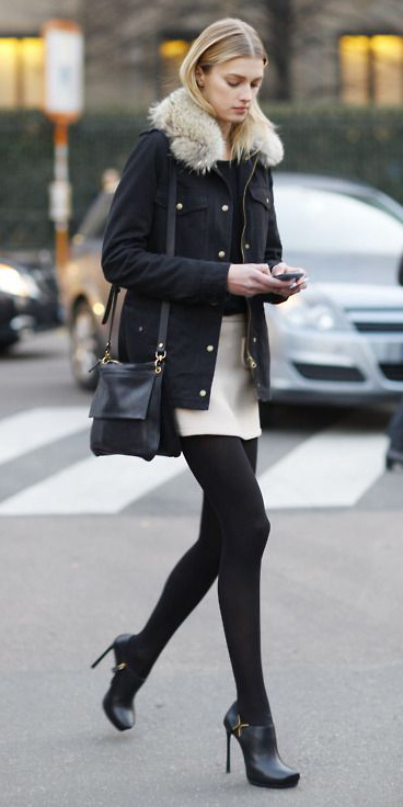 white-mini-skirt-black-tee-black-bag-wear-style-fashion-fall-winter-black-jacket-coat-parka-black-shoe-booties-black-tights-model-off-duty-blonde-dinner.jpg