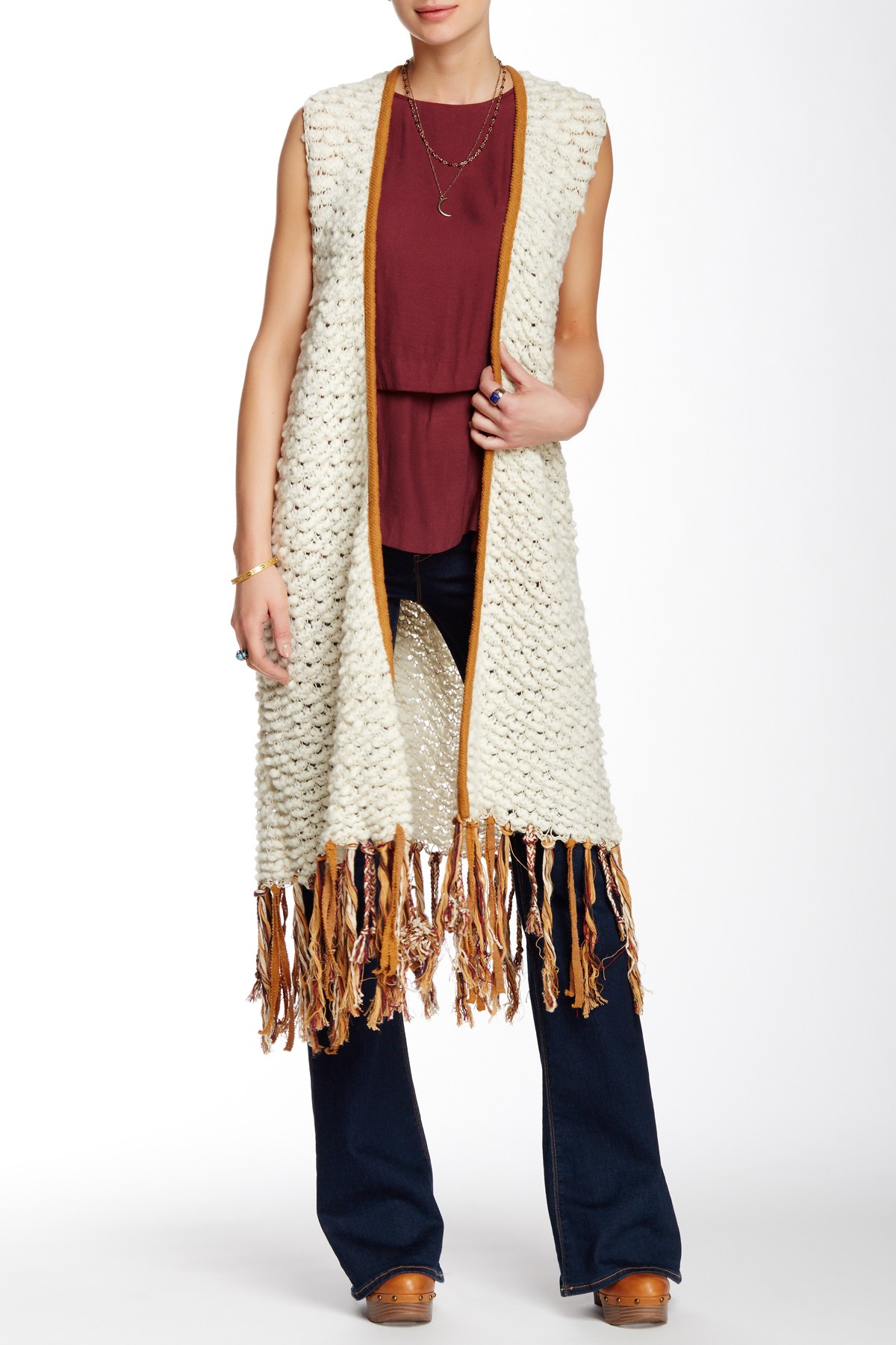 blue-navy-flare-jeans-burgundy-top-white-vest-knit-cognac-shoe-booties-fringe-fall-winter-lunch.jpg