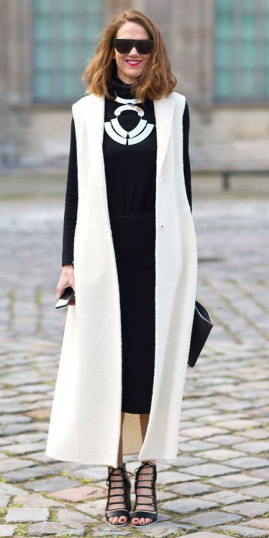 black-midi-skirt-black-sweater-turtleneck-bib-necklace-hairr-sun-black-shoe-sandalh-white-vest-knit-maxi-fall-winter-dinner.jpg