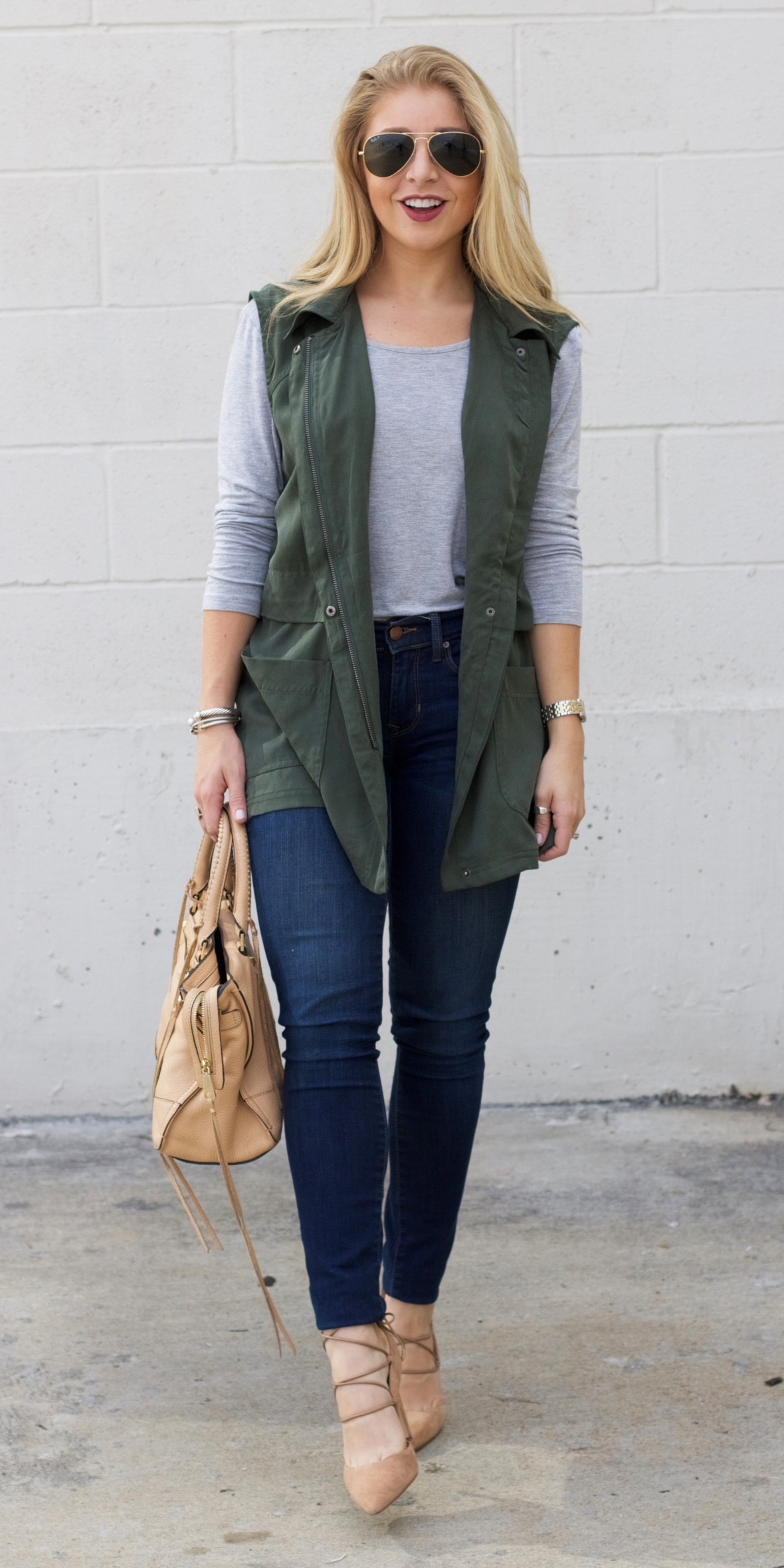 blue-navy-skinny-jeans-grayl-tee-green-olive-vest-utility-blonde-sun-tan-bag-tan-shoe-pumps-fall-winter-lunch.jpg