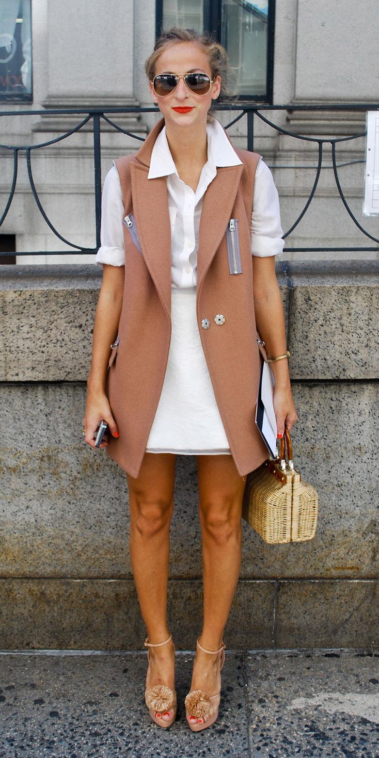 white-mini-skirt-camel-vest-tailor-blonde-bun-sun-tan-bag-straw-white-collared-shirt-tan-shoe-sandalw-spring-summer-lunch.jpg