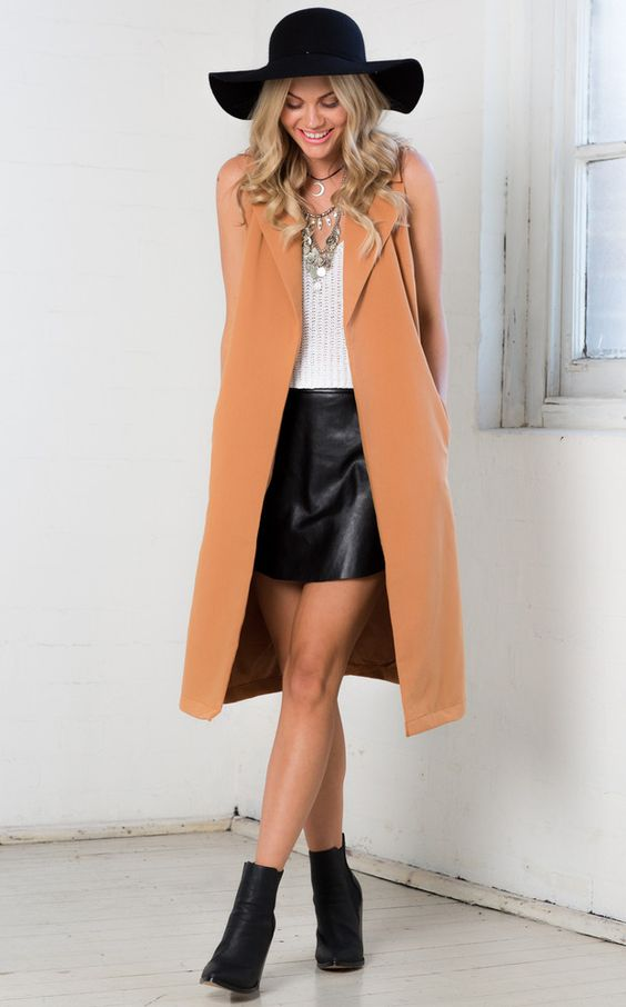 black-mini-skirt-white-cami-necklace-camel-vest-tailor-blonde-hat-black-shoe-booties-spring-summer-lunch.jpg