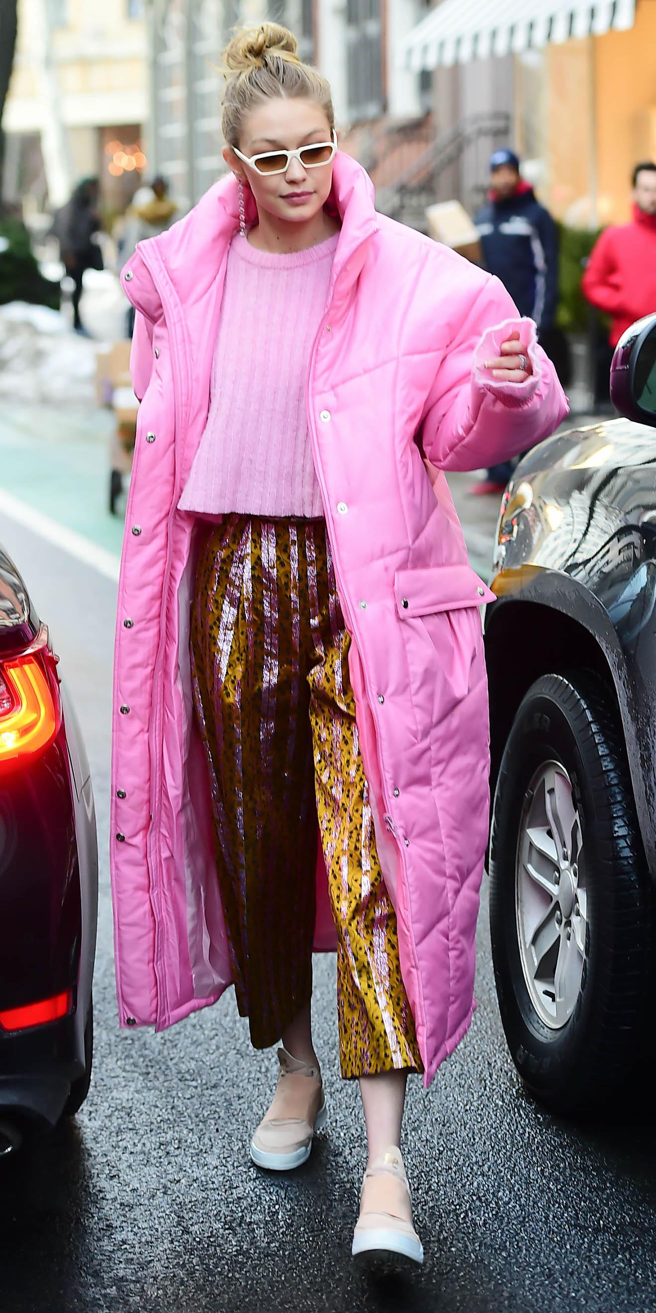 yellow-joggers-pants-tan-shoe-sneakers-pink-light-sweater-blonde-sun-bun-pink-light-jacket-coat-parka-puffer-gigihadid-fall-winter-weekend.jpg