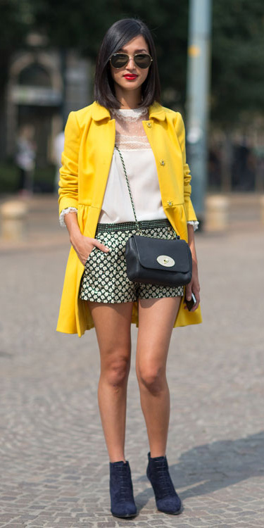 black-shorts-print-white-top-blouse-brun-sun-black-bag-blue-shoe-booties-lob-yellow-jacket-coat-fall-winter-lunch.jpg