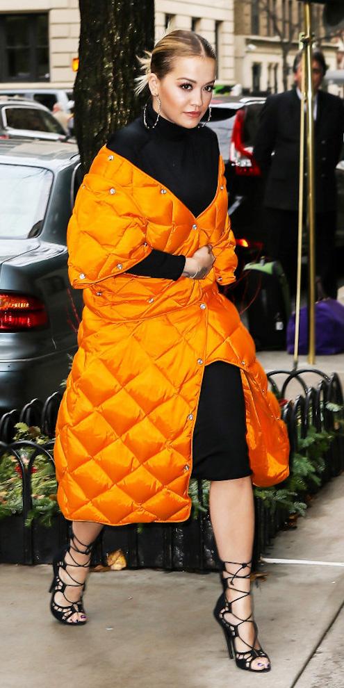 black-dress-sweater-hoops-bun-black-shoe-sandalh-ritaora-orange-jacket-coat-puffer-fall-winter-blonde-dinner.jpg