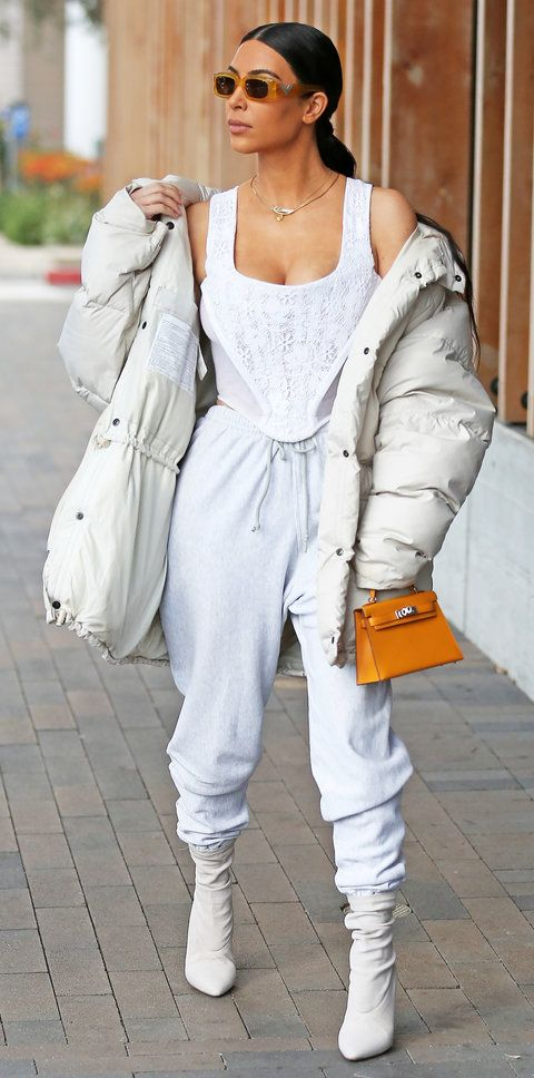white-joggers-pants-white-cami-sun-pony-yellow-bag-white-shoe-boots-kimkardashian-white-jacket-coat-puffer-fall-winter-brun-lunch.jpg