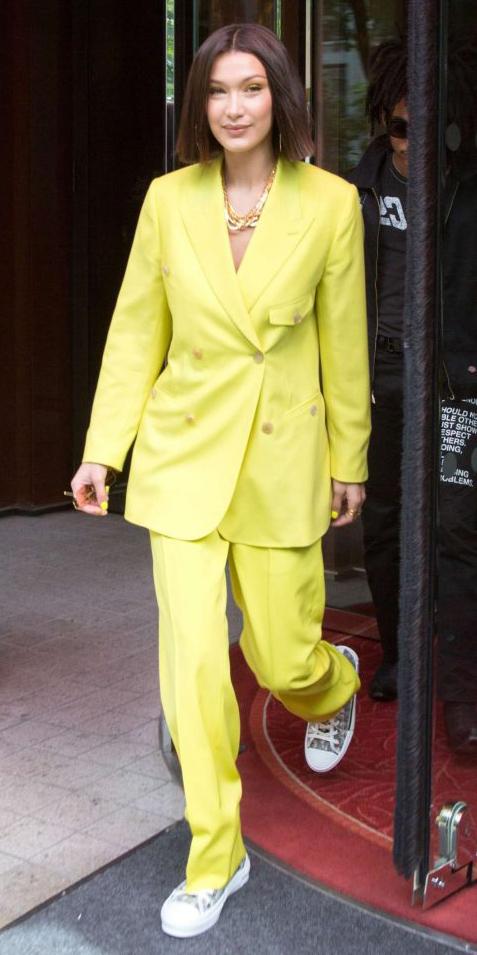 yellow-wideleg-pants-suit-yellow-jacket-blazer-necklace-brun-white-shoe-sneakers-bellahadid-spring-summer-lunch.jpg
