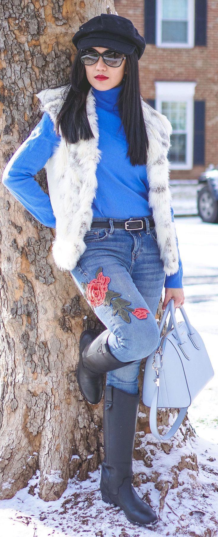 blue-med-skinny-jeans-black-shoe-botos-belt-blue-med-sweater-turtleneck-white-vest-fur-hat-brun-sun-blue-bag-fall-winter-weekend.jpg