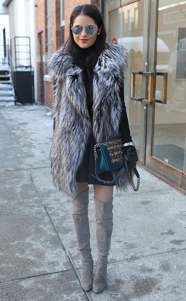 black-mini-skirt-black-sweater-grayl-vest-fur-green-bag-sun-howtowear-fashion-style-outfit-fall-winter-basic-gray-shoe-boots-crossbody-gloves-turtleneck-brun-dinner.jpg