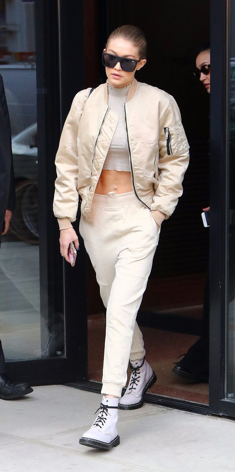 white-joggers-pants-white-shoe-booties-combat-tan-jacket-bomber-gold-metallic-sun-bun-gigihadid-drmartens-spring-summer-blonde-weekend.jpg