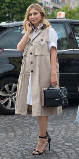 white-dress-shirt-tan-vest-trench-blonde-black-bag-black-shoe-sandalh-layer-spring-summer-work.jpg