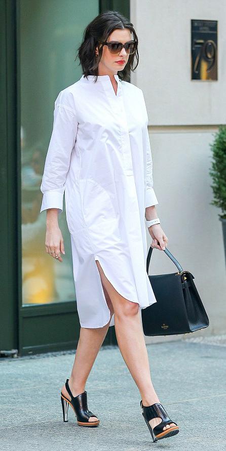 white-dress-black-shoe-sandalh-black-bag-hand-sun-shirt-wear-style-fashion-spring-summer-work-annehathaway-celebrity-street-brunette-work.jpg