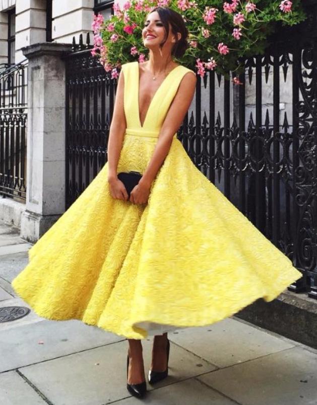 what-to-wear-for-a-summer-wedding-guest-outfit-yellow-dress-midi-bun-black-shoe-pumps-black-bag-clutch-dinner.jpg