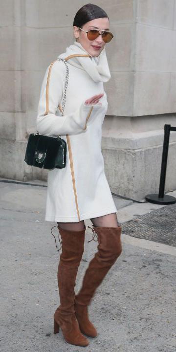 white-dress-sweater-bellahadid-sun-bun-turtleneck-cognac-shoe-boots-otk-black-tights-fall-winter-brun-dinner.jpg